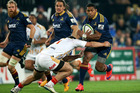 Waisake Naholo of the Highlanders is tackled during the Super Rugby Qualifying Final match. Photo / Getty Images
