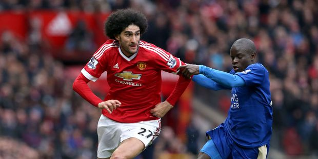 Manchester United's Marouane Fellaini, left, and Leicester City's N'Golo Kante chase the ball during their English Premier League soccer match. Photo / AP.