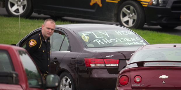 Mourners arrive at Dry Run Church of Christ as authorities provide security before funeral services for six of the eight murder victims from Pike County. Photo / AP
