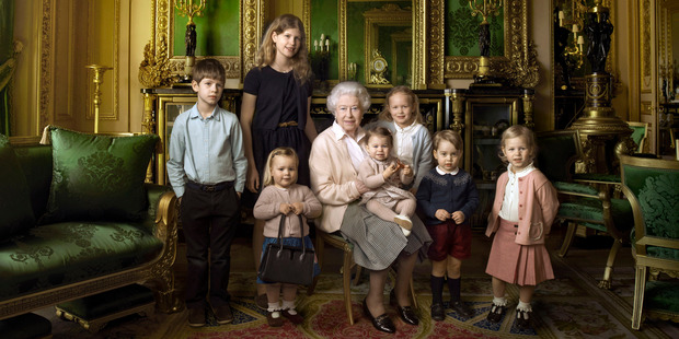Queen Elizabeth II with her five great-grandchildren and her two youngest grandchildren. Princess Charlotte is sitting on her lap. Photo / Buckingham Palace