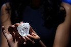 A model displays the Lesedi La Rona diamond at Sotheby's in New York. Photo / AP