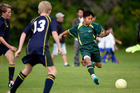 Vincent Phirun, 13, in action for Mount Maunganui under-13s against Aquinas College. Photo / George Novak