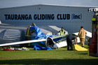 Emergency services at the scene of a glider crash at Tauranga Airport. Photo/George Novak