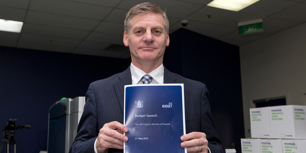 Finance Minister Bill English with copies of his Budget 2015 at PrintLink in Petone. Photo / Mark Mitchell