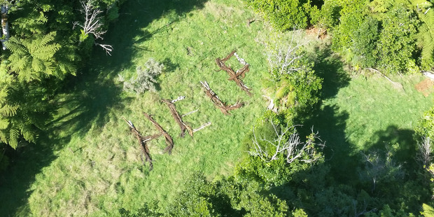 A help sign made by missing trampers Rachel Lloyd (22) a student at Massey University and her mother Carolyn Lloyd (45) from the United States. Photo / Supplied