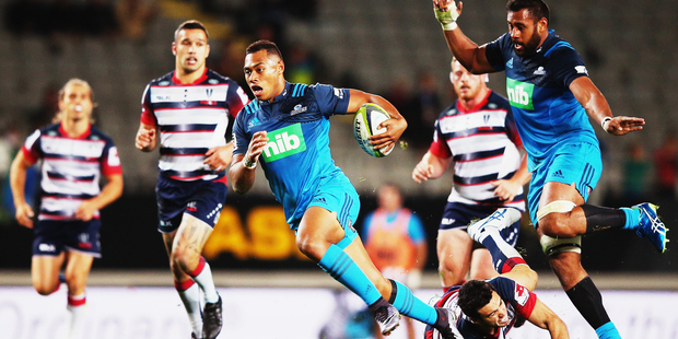 Blues winger Tevita Li makes a break during the Super Rugby round ten match against the Melbourne Rebels. The team is hoping some new tech will help them recover from the stresses of a big trip to South Africa. Photo / Getty