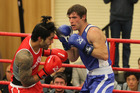 Poasa Naoia (red), of Flaxmere, and Alastair Young (blue), of Hastings, measure their worth in the novice elite 75kg bout at Hastings Intermediate School on Saturday. Photo / Duncan Brown