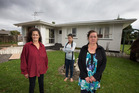 Outside their mothers old house in Papakura, sisters Dawn Sillick, left, with her daughter Elyshia, centre, and Mary Edmonds, right. Photo / Brett Phibbs