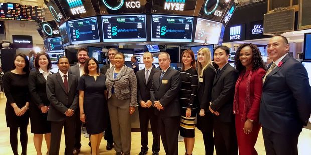 Employees who work under parent company, Global Payments, rang the New York Stock Exchange bell on April 25, including Carterton businessman Richard Etti, far right. PHOTO/SUPPLIED