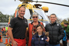 Life Flight's open day at Fagan Motors in Masterton. From left, pilot Dean Herrick, rescue survivor Barbara Bilski and her granddaughters Kendra Fox, 8, left, and Alyssa Fox, 13. PHOTO/PETE MONK