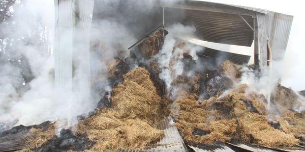 An overnight barn fire on Rutland Rd in Carterton, still burning this morning. PHOTO/ANDREW BONALLACK
