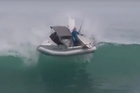 A video has emerged on social media of the moment a boat with surfers on board is capsized by a large wave. Source: Facebook / Ian Ruru