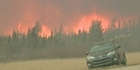 Watch: Watch: Rain needed for Canadian wildfire