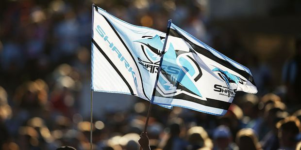 Young Sharks fans fly flags before a game. Photo / Getty