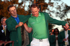 Jordan Spieth (L) presents Danny Willett with the green jacket after Willett won the 2016 Masters Tournament. Photo / Getty