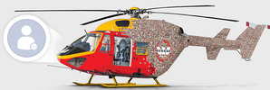 Is it a bird? Is it a plane? No, it's your face on the side of a chopper
