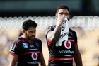 Konrad Hurrell and Manu Vatuvei of the Warriors.