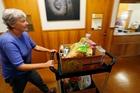 Volunteer Helen Reynolds keeps on top of demand at Whangarei's food bank. Photo / John Stone