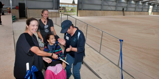 13-year-old Shyla-Mei Corbett (centre) cuts the ribbon with Olympian Heelan Tompkins (left), mum Nicole Corbett (rear) and Linda Hunt from Riding for the Disabled. Photo / Ben Fraser