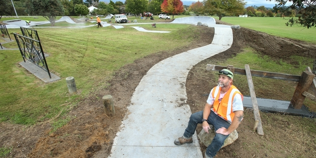 JOB DONE: Skate path builder 'J' Beaudry takes a breather from putting the finishing touches to Omokoroa's new path.PHOTO/JOHN BORREN