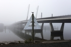 Whangarei's Te Matau o Pohe bridge is shrouded in fog. Photo / Michael Cunningham