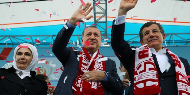 Recep Tayyip Erdogan (left) and Ahmet Davutoglu put on a united front when in public. Photo / AP