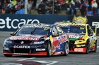 Shane Van Gisbergen takes control in race one at Perth for team Triple Eight. Team-mate Craig Lowndes later passed the Kiwi. Photo / Getty Images