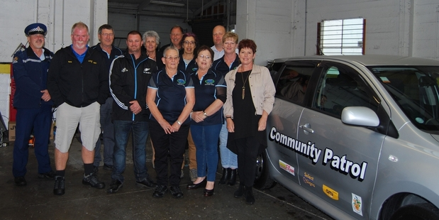 NEW CAR: Masterton Community Patrol members, police and sponsors gather to celebrate the handover of the keys to the new Community Patrol car.PHOTOS/ALISA YONG