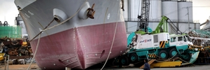 A ship lies stranded on a wharf after the 2011 tsunami that devastated Japan.