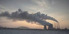 FOSSIL FUEL: Sun, chimneys and fumes above a coal power plant.PHOTO/SUPPLIED
