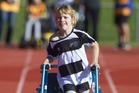LOVING IT: Liv Fountain digs deep in the 100m sprint of the annual Halberg Junior Disability Games in Hamilton. PHOTO/John Cowpland www.photosport.nz