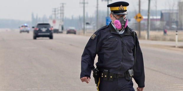 Police officers controlling traffic protected themselves against the smoke.