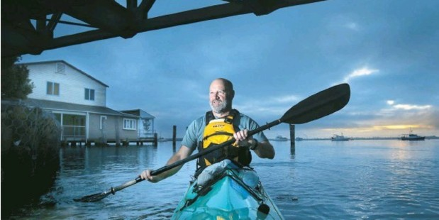 Loading SEA JOURNEY: Welcome Bay man Ross Mahon paddles his kayak to work at the Trustpower building in Tauranga CBD.