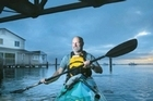 Welcome Bay man Ross Mahon paddles his way to work when the tides are just right. No traffic on the water! See how he does it in the video.