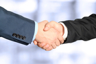 A handshake really could help seal the deal. Photo / iStock