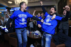 Leicester City fans celebrate in Hogarths public house in Leicester. Photo / AP