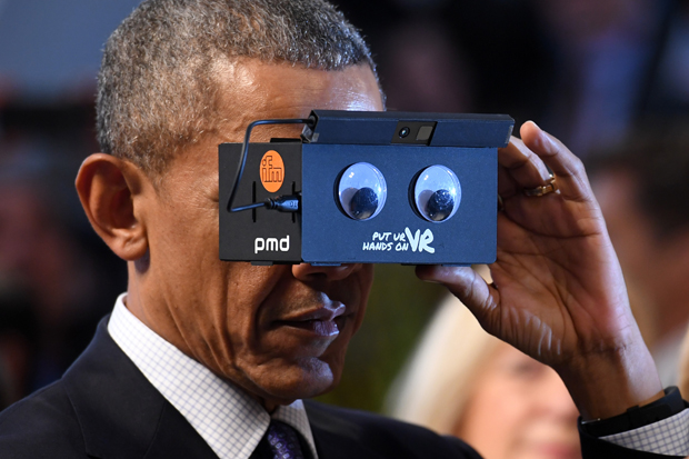 Barack Obama tried on some virtual reality glasses at a recent technology fair in Germany. Photo / Getty