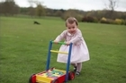 She may be a month behind her big brother, but Princess Charlotte has started walking, as a first birthday picture taken by the Duchess of Cambridge shows.