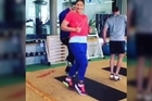 Valerie Adams has added to the running man craze, dancing with her trainers during a workout.