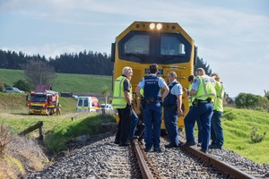 Police and other emergency services gather on the tracks where a woman was hit by a train at Otamarakau. Photo/George Novak