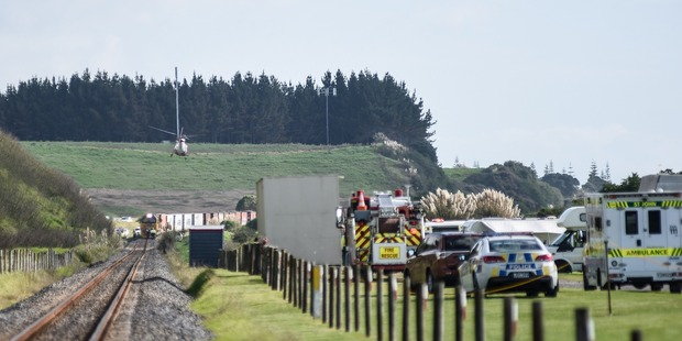 A rescue helicopter leaves the scene where a person has been hit by a train at Otamarakau. Photo/George Novak