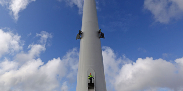 An employee exits a Vestas V164 wind turbine in Osterild . Photo / Bloomberg