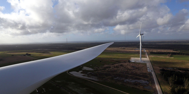 The giant blade of a Vestas V136 points towards a Vestas V164 wind turbine during operational testing at  Osterild. Photo / Bloomberg