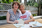 Ritva Hellberg and Maxine Neustroski with one of the first letters they ever sent. Photo / Supplied, Liam Clayton
