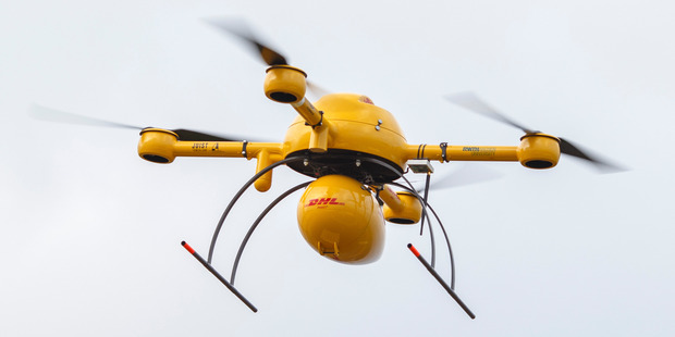 DHL parcel delivery drone, manufactured by Microdrones GmbH, as it flies during testing by Deutsche Post AG's parcel delivery unit in Norddeich, Germany. Photo / Bloomberg