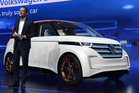 Herbert Diess, head of the VW brand and member of the board of management at Volkswagen AG, stands beside the BUDD-e long-distance electric vehicle at the 2016 Consumer Electronics Show. Photo / Bloomberg