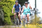 Recreational cyclists Dave and Linda Hanley from Wellington enjoy the sunshine yesterday. Photo / Duncan Brown