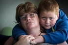 Shona Maiden, with son Johnny, 7, says she lost five teeth in the attack. Photo / Jason Oxenham