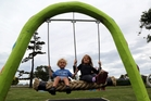 Christian Stewart, 4, and sister Hayley, 7, enjoy the new swing attached to the snake at Kowhai Park