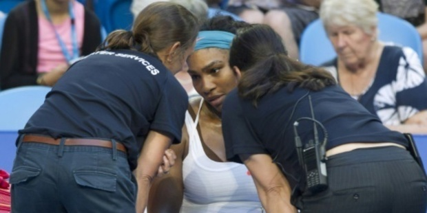 Serena Williams receives medical attention. Photo / Getty
